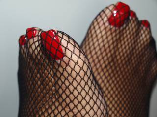 toes in fishnet stockings
