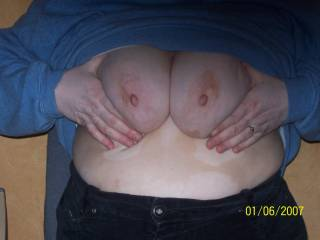 Great photo, beautiful lady,beautiful tits. I would love to feel them wrapped around my cock for a titty fuck and then to cum on each nipple in turn