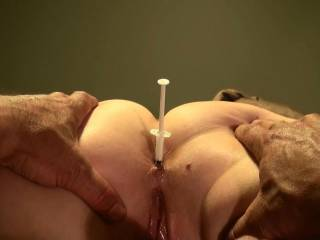 His new way of lubing my Ass...now he's just gotta push the plunger to let the fun begin!!!