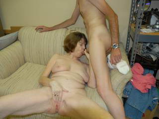 His wife sucking my cock while he watches and takes photos