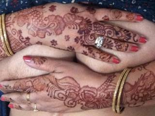 Indian wife\'s big tits covered by her beautiful, decorated hands.
