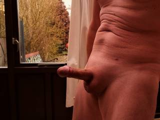Fully nude by the window.