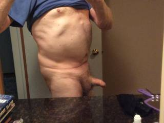 Uncut, with foreskin covering the head