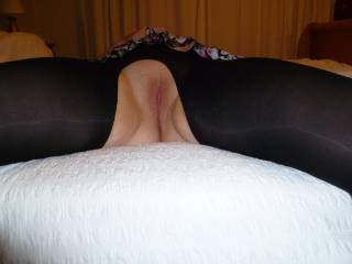 This is my wife spread out on the bed....she has black nylons on and was ready to be fucked really hard - see the other picture of how I covered her legs with my cum!