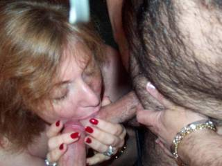Nice of her to take care of them, but then she needs them hard in order to fuck her well. Love the way she is lovingly taking great care of the cock heads and cumholes, holding them carefully so they don't twitch and flop out of her cargiving mouth