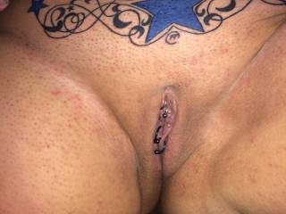 I fuckin love this tattooed and pierced wife that I got. And the pussy is..... Well, would you like to know? P.s. And the blowjobs. WOW watch the videos and you tell me what you think. Should share her?????