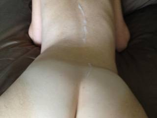 I unleashed a load on her back because I wanted to lick her pussy later that afternoon!