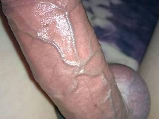 My cock all oiled up and a rope tight around his balls. You see how purple his head is?