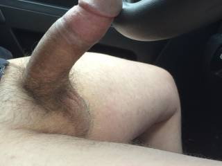 Resting my cock on the steering wheel.