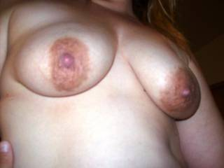 Lupo's wife riding me cowgirl.  Doesn't her nipples look all swollen and puffy after I've sucked on them and she's fucking me???