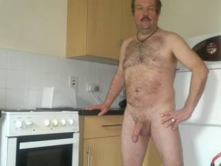 posing naked in the kitchen showing of my adequate cock
