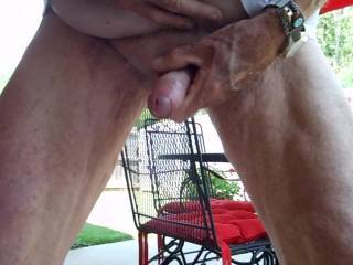 Stripped off and jacked my cock until I shot my load, before mowing the back yard last week.