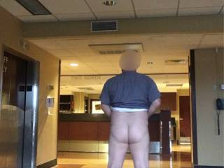 The nurses were off giving mess to the patients. Dropped my pants and took a quick picture before they came back. Almost got caught!  Just as I finished pulling up my pants, the elevator doors opened!