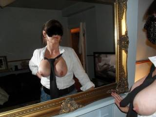 Touching her tits as she watches porn in the mirror xxxxxxxxxxxxx