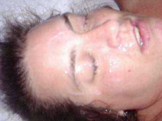 big load dumped on her face. Would you like to add some more?
