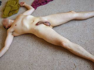 Stripped off and waiting for sex on the carpet