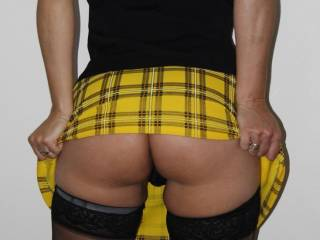 Watch this very naughty school girl undress...tell her what you want...